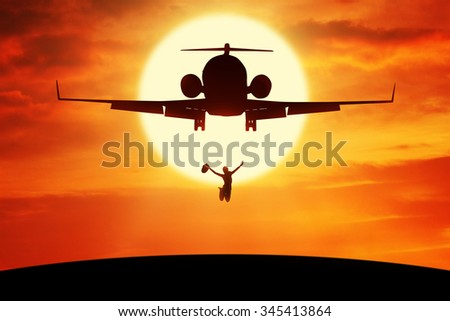 Silhouette of happy woman holding hat and enjoy holiday while jumping on the hill under flying plane