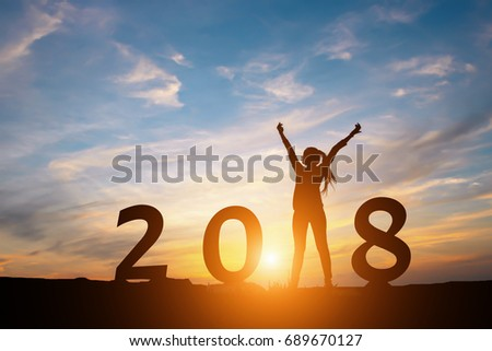 Silhouette of happy woman with New year 2018 concept in sunset background. #689670127