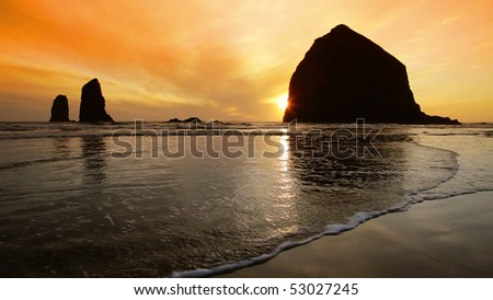 Silhouette of Haystack Rock at sunset, Cannon Beach, Oregon