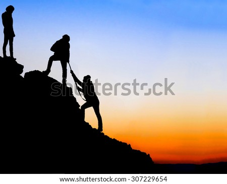 Silhouette of helping hand between three climber