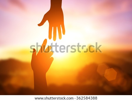 silhouette of helping hand concept and international day of peace.Thank You For Your Support. how can i help you. international day of peace.develop a friendship.please help me.