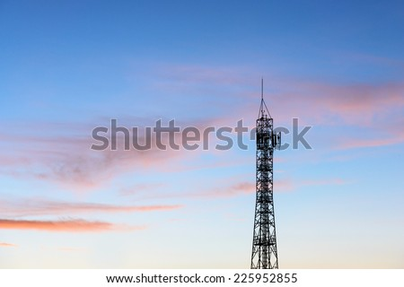 Silhouette of high communication antenna in sunset time in morning and evening time