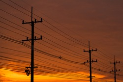 silhouette of high electric power pole with Copy-Space.