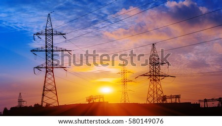 Shutterstock Silhouette of high voltage electrical pole. Sunset sky background