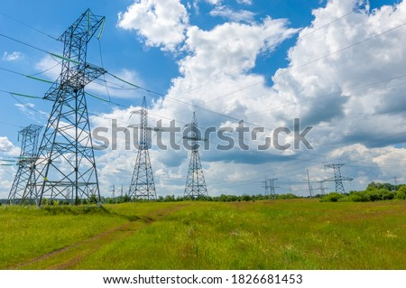 Silhouette of high voltage poles, power tower, electricity pylon, steel trellised tower, in the afternoon in the European part. Texture high voltage pillar, overhead power line ストックフォト ©