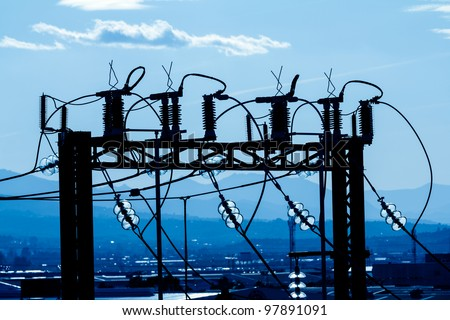 Silhouette of high voltage substation part in an industrial area