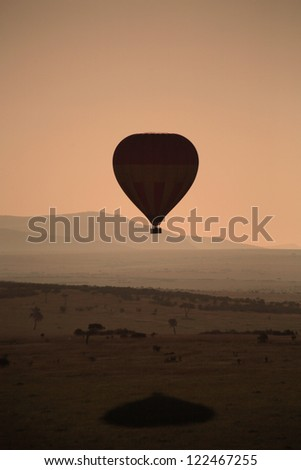 Silhouette of hot air balloon at sunrise over the Masai Mara Kenya Africa
