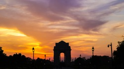 Silhouette of India Gate against amazingly beautiful sunset and sky