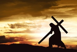 Silhouette of Jesus carry his cross on the hill