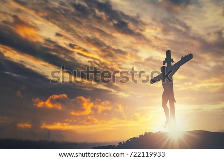 Silhouette of Jesus christ crucifix cross on heaven sunset concept - Christmas catholic religion, christian worship, happy Easter Day,  praying praise good friday morning sunrise background, bible