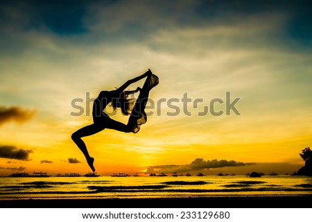 silhouette of jumping girl on tropical sunset sea and sky background #233129680