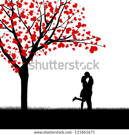 Silhouette of kissing couple beside love tree