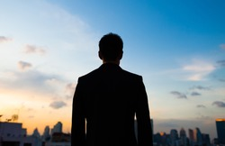 Silhouette of male in the city.