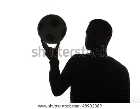 Silhouette of man holding ball in air, isolated on white background.