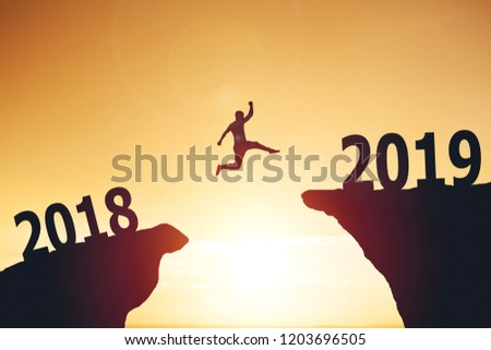 Silhouette of man jumping from 2017 to 2018 text #1203696505