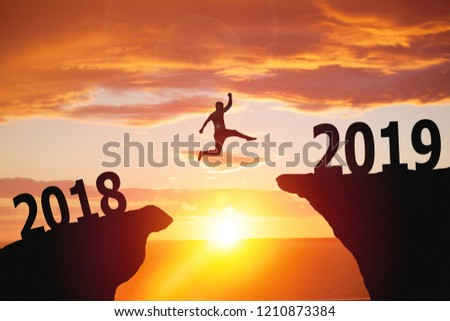 Silhouette of man jumping from 2018 to 2019 text #1210873384