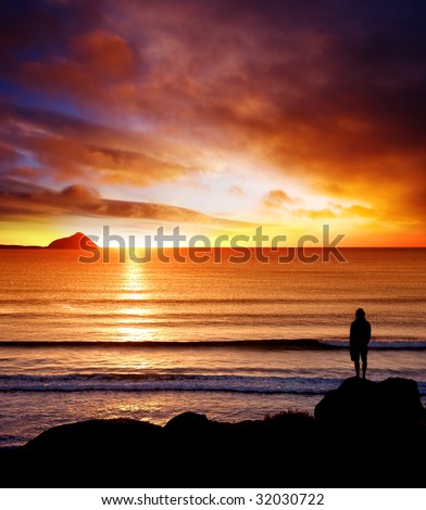 Silhouette of man looking into the sunset