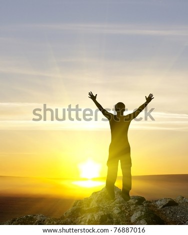 silhouette of man on the sunset on top of the mountain. #76887016