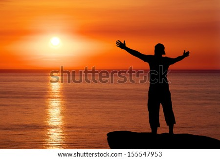 Silhouette of man on top of mountain at sunset. Man on peak of mountain. Conceptual design.