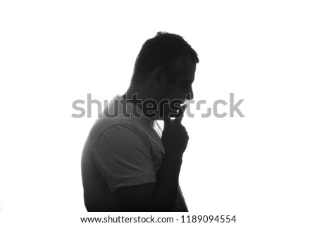 Silhouette of man posing on white background. Close up. place for text. #1189094554