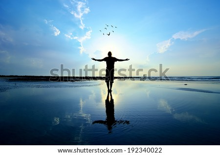Silhouette of Man Raising His Hands or Open arms when sun rising up #192340022