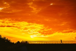 Silhouette of man running on sunset, fitness and healthy life concept