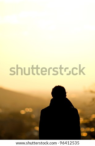 silhouette of man standing over freiburg in sunset #96412535