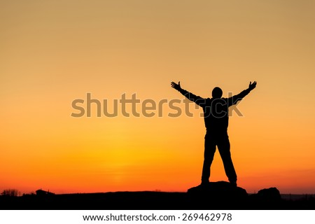 Silhouette of man with arms raised up and beautiful sky. Element of design. Summer sunset. Background #269462978