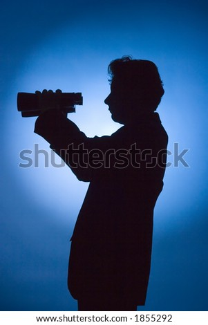 silhouette of man with binoculars on blue background