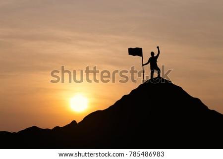 silhouette of men holding flag...