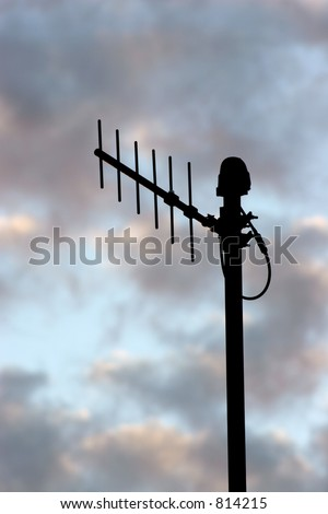 silhouette of microwave antenna on colorful clouds at sunset
