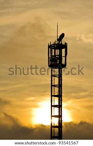 Silhouette of mobile phone antenna in orange sunset, in Japan