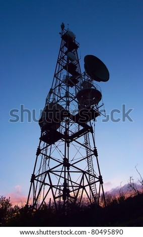 silhouette of mobile phone communication antenna tower on night sky background
