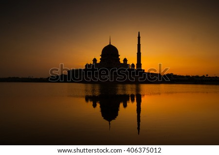 Silhouette of Mosque with reflection from the lake during sunrise at Putrajaya, Malaysia. #406375012