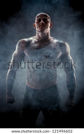 Silhouette of muscular man