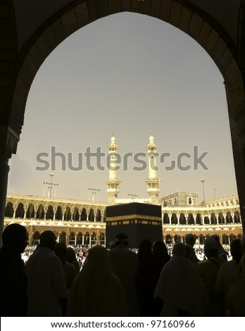 Silhouette of Muslim pilgrims get ready to circumambulate the Kaabah.