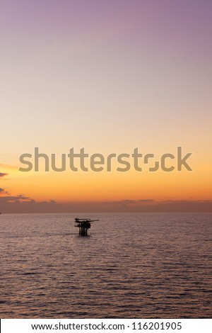Silhouette of Offshore Production Platform in Evening Time