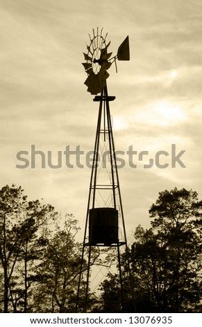 silhouette of old fashioned windmill water tower