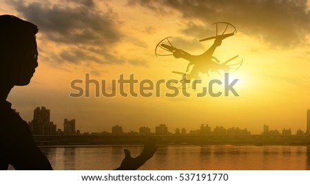silhouette of one man use a drone flight #537191770