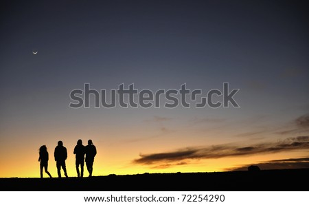 Silhouette of people and photographers on mountain at dawn. Silhouettes of people against the night sky. After a decline.