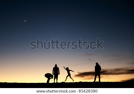 Silhouette of people and photographers on mountain at dawn. Silhouettes of people against the night sky. After a decline. - stock photo