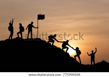 silhouette of people helping...