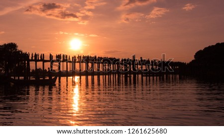 Silhouette of people walking on Bridge U-Bein at sunset scene in Amarapura, Mandalay, Myanmar #1261625680