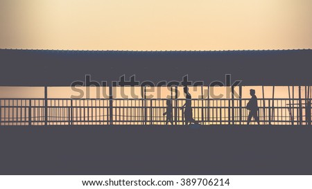 silhouette of people walking on ...