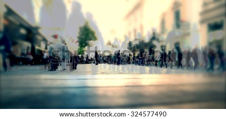 Silhouette of people walking on the street of big city shopping day, big crowd of people walking - Shutterstock ID 324577490