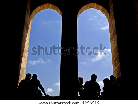 Silhouette of peoples and windows at a castle