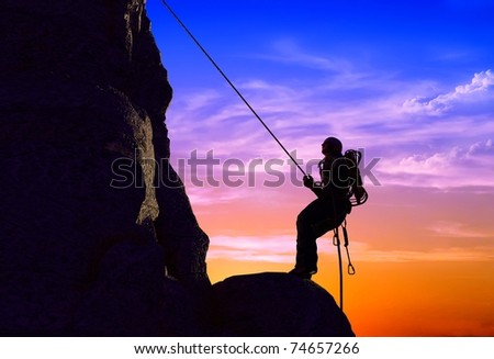 Silhouette of peoples in the mountains - stock photo