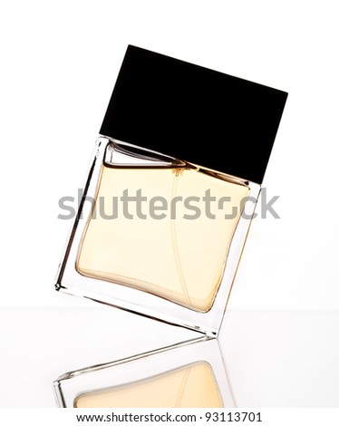 Silhouette of perfume bottle on a white backdrop