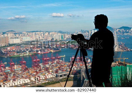 silhouette of photographer shooting city landscape