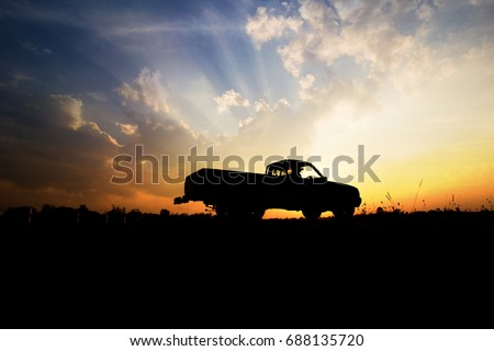Silhouette of pickup truck on the background of beautiful sunset